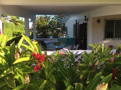 View of the large verandah with exotic ginger lilies