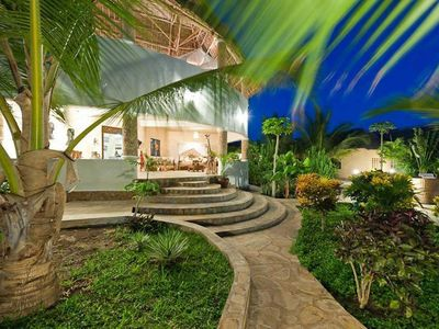 Photo for Immersed in fabulous tropical gardens,close to the beach.