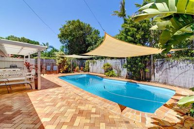 solar heated pool with 2 shade sails, next to undercover area, 2 pool gates