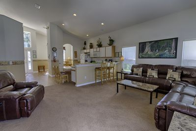 Living area and kitchen with breakfast bar