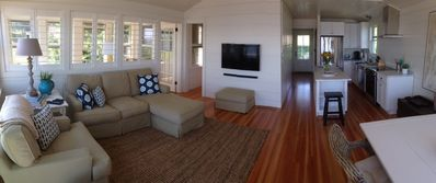 Open Living Room And Kitchen with Flat Screen TV & surround sound
