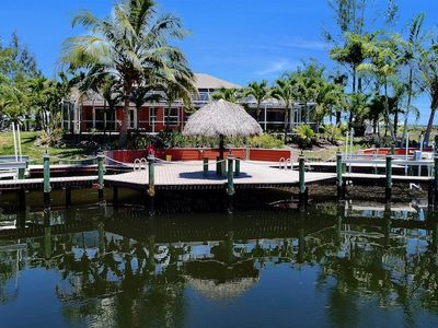 Photo for Palm Breeze - Cape Coral 3b/2ba  luxury home with heated pool on gulf access canal, HSW Internet