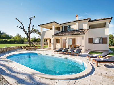 Photo for Modern 3 bedroom villa w/ heated pool, free Wi-Fi, outdoor dining & BBQ