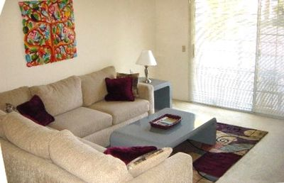 THE LIVING ROOM IS AN PERFECT PLACE TO RELAX!   STEP ONTO THE BALCONY TO GRILL.