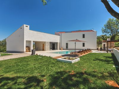 Photo for Modern peaceful villa with large pool in green surroundings offering privacy