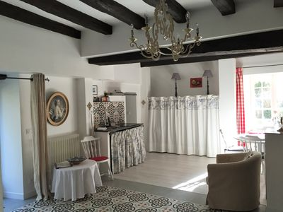 All in the same room as so-called loft in France: kitchen, dining, seating, bed