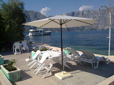 Photo for Seaside 2 bedroom apartment,with waterfront terrace,5 meters to the sea