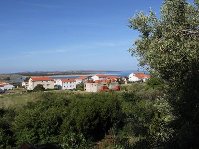 Photo for Comfortable and spacious apartment with terrace and sea view Povljana (Pag)