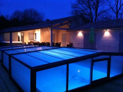 Photo for Near soulac / sea house 16 people, indoor heated pool 28 °, jacuzzi, sauna