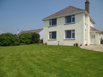 Photo for Spectacular sea views from this recently renovated 4 bed holiday home