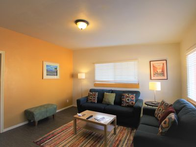 Photo for Downtown condo w/ shared hot tub/grill, walk to dining/shopping, 2 dogs OK!