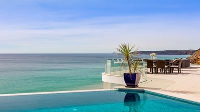 Photo for Outstanding lux beach-front property with o pool and breathtaking ocean views.