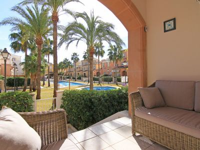 Photo for Beautifully furnished 4 bedroom townhouse, communal pool, secure gated community
