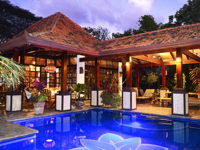 Photo for Exquisite Balinese Style Villa with stunning views, private heated pool & garden