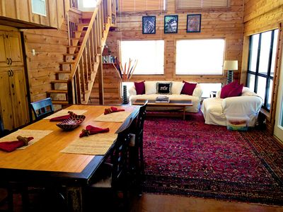Living area.  The windows behind couch face the cliff.