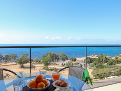 Photo for Oceanfront apartment with amazing views, shared pool, & easy beach access