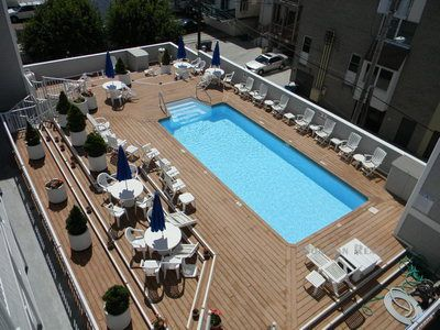 Plenty of tables and chairs for relaxing by the pool