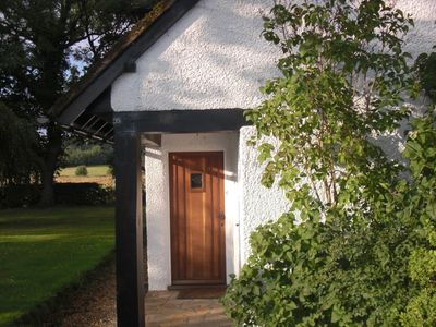 solid oak private front door very close to private parking area