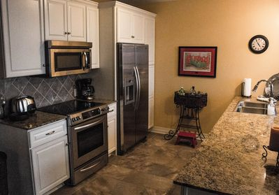 Beautiful, clean kitchen with stainless steel appliances.