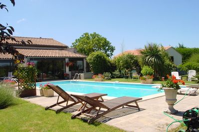 Your gite, with garden room/terrace opening onto pool & garden