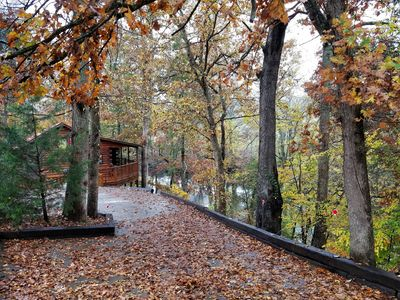 Photo for Lazy River-remodeled log cabin right on river bank-WIFI-PetsOK-HotTub, Sleeps5+
