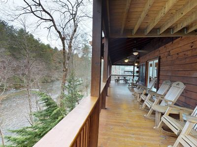 Photo for Riverfront cabin with private hot tub, free WiFi, and a great location!