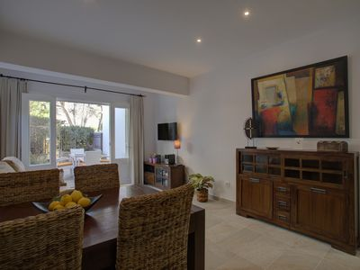 Photo for Cozy and modern property only a few steps from the sandy beach