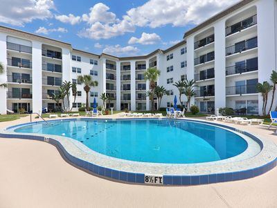 Photo for NEW LISTING! Updated condo w/ full kitchen, balcony, & shared pool - near beach!