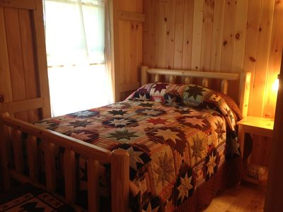 Amish made furniture and hand made quilt in downstairs bedroom.