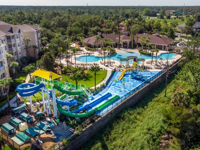 Photo for Luxury villa 2 miles to Disney w/ theme rooms, game room, south facing pool.