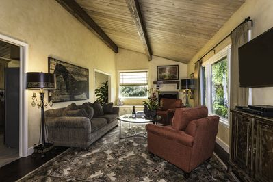 Living room with comfortable seating, flat screen TV and recent DVD selections.