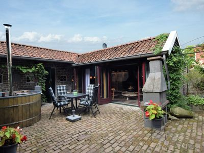 Photo for Cozy Holiday Home in Musselkanaal with Hot Tub