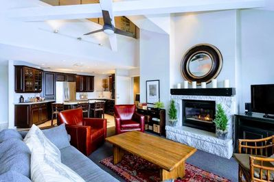 Great Room with Stone Fireplace.  Note: large LED flat screen now above mantle.