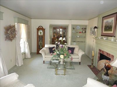 The lovely living room, with the dining room entrance.