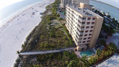 BEACH VIEW OF CONDO AND POOL PLUS BOARDWALK TO BEACH