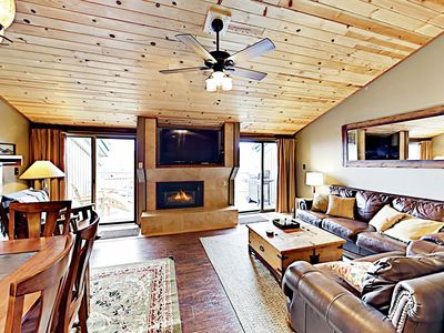 """Main Living Area - An expansive living area boasts a 55"""" flat-screen TV and gas fireplace."""
