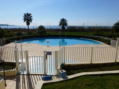 Photo for Juan Les Pins Ground floor studio with pool, facing the sea, 5mn from the beach
