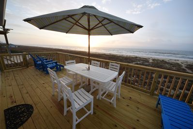 watch the sunrise over the ocean from the decks