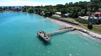 Photo for Right on the lake with private beach. Playground, sports facilities.