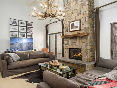 Photo for Upscale chic condo close to the slopes with shared hot tubs & winter shuttle