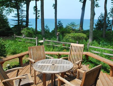 Your deck and view of natural garden and Lake Michigan on The Bluff