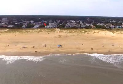 Beautiful wide beach at 70th Street. Red arrow shows the house location.