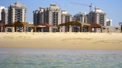 the building sight from the beach