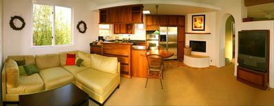 Panoramic view of living room and kitchen.
