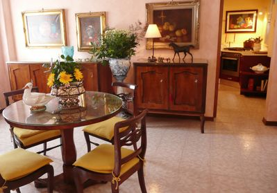 Dining table for four, in the den there is a larger table