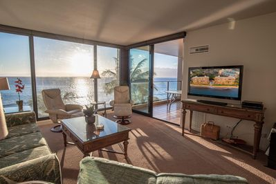 Living room looking towards large floor to ceiling windows and lanai.