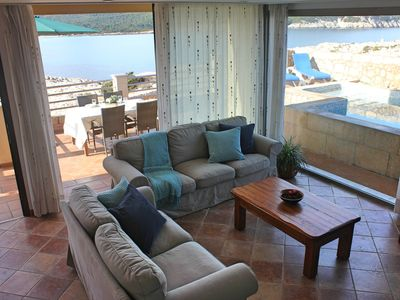 Photo for Townhouse with private pool in front of the sea