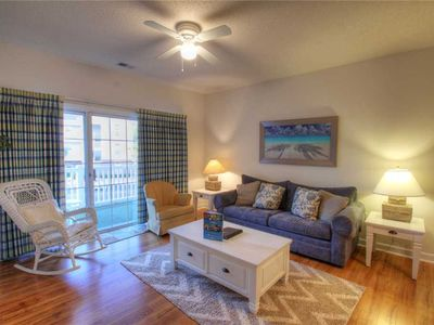 Photo for Vibrantly furnished villa located by the famous Greg Norman Golf Course Barefoot Resort!