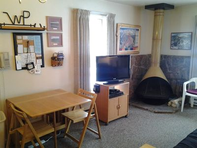 Flat-screen TV, Blu-Ray DVD/CD player, free WiFi, & wood-burning fireplace.