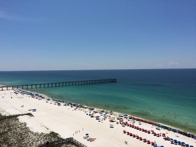Fishing pier, July view from condo balcony Lots of space on the beach.